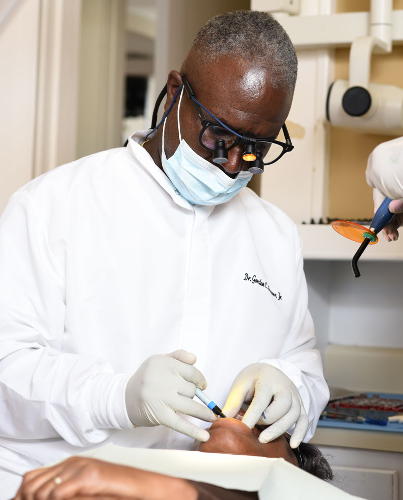 Our Periodontist, Dr. Fraser, examining a dental patient